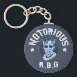 "Notorious RBG III Keychain<br><div class=""desc"">Ruth Bader Ginsburg in a crown &amp; dark glasses,  with,  &quot;Notorious R.B.G&quot; in badass lettering. Shades of blue. T-shirts,  novelty gift swag.</div>"