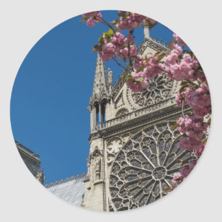 Notre Dame in Paris, France with Spring Flowers Classic Round Sticker