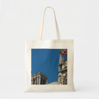 Notre Dame in Paris, France with Spring Flowers Tote Bag
