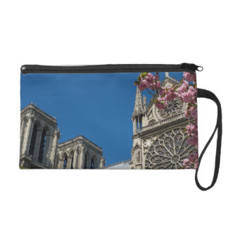 Notre Dame in Paris, France with Spring Flowers Wristlet Purses
