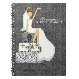 Novia triguena en el pastel de bodas cuadernos