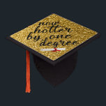 """Now hotter by one degree. Glitter gold Graduation Cap Topper<br><div class=""""desc"""">Hats off to the graduate. Stand out in the crowd at the commencement ceremony with this custom tassel topper.   &quot;Now hotter by one degree&quot; in handwritten style. Faux glitter gold graduation cap tassel topper.  Find a silver version here: https://www.zazzle.com/now_hotter_by_one_degree_glitter_silver_graduation_cap_topper-256172512701425479  Look for more items at: https://www.zazzle.com/artofreiki*  &#169;ArtofReiki</div>"""