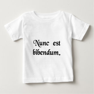 Now we must drink. baby T-Shirt