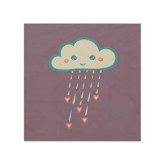 Nube de lluvia azul feliz que llueve corazones impresiones en madera