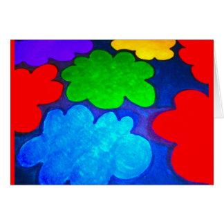Nubes coloridas de las palomitas tarjeta