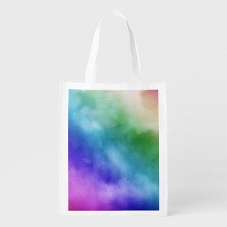 Nubes de la acuarela en tonalidades del arco iris bolsa para la compra