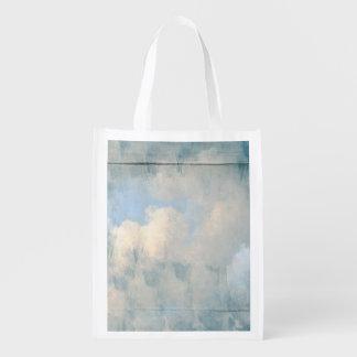 Nubes mullidas azules que pintan el fondo bolsa reutilizable