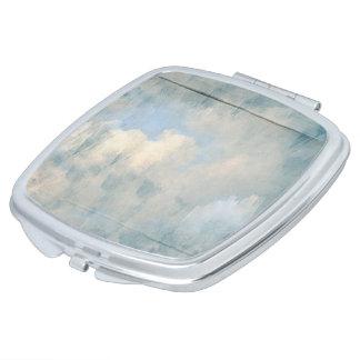 Nubes mullidas azules que pintan el fondo espejo para el bolso