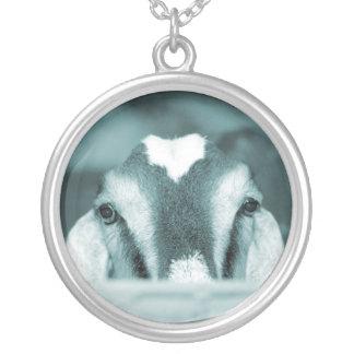 Nubian doe bw blue peeking over wooden rail silver plated necklace