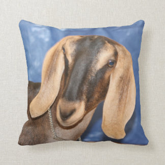 Nubian doe head against blue throw pillow