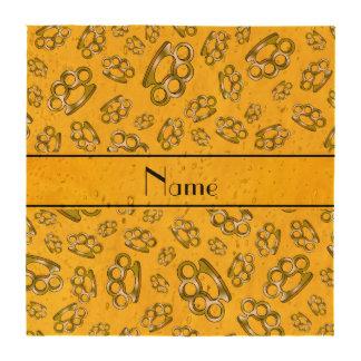 Nudillos de cobre amarillo amarillos conocidos per posavasos