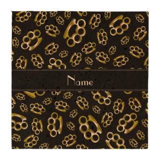 Nudillos de cobre amarillo negros conocidos person posavasos