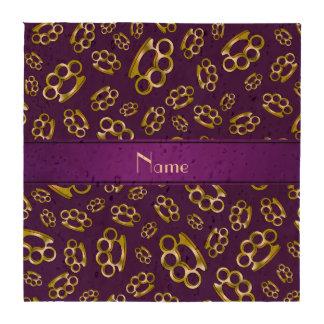 Nudillos de cobre amarillo púrpuras conocidos posavasos
