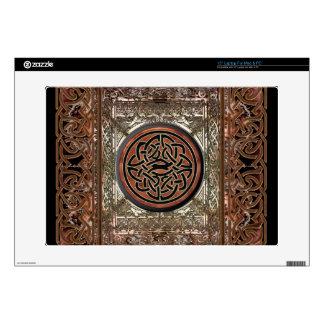 Nudo céltico de cobre místico en la tapicería con portátil skins