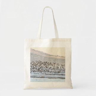 Nudo en la costa bolsas