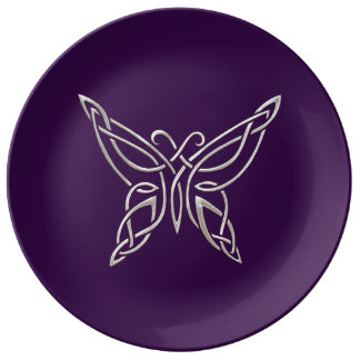 Nudos que se encrespan de la mariposa céltica platos de cerámica