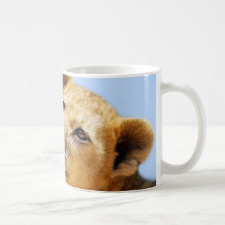 Nuestras caras lindas del león taza de café