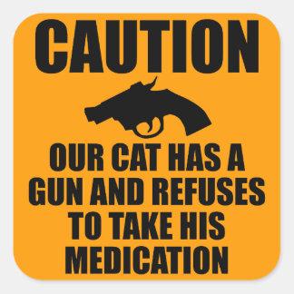 Nuestro gato tiene un arma calcomanías cuadradass