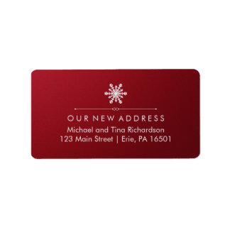 Nueva dirección del navidad en rojo elegante y el etiquetas de dirección