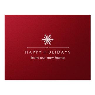 Nueva dirección en el navidad rojo y el copo de postales