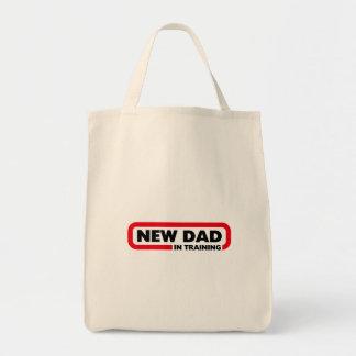 Nuevo papá en el entrenamiento bolsa tela para la compra