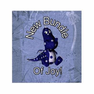 Nuevo paquete de alegría con el fondo azul del azu esculturas fotograficas