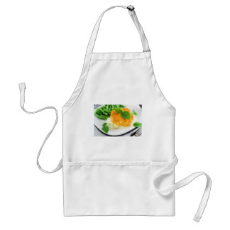 Nuggets of chicken, mashed potatoes and green bean adult apron