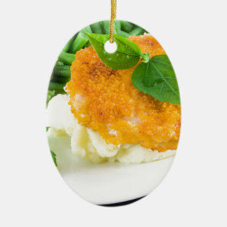 Nuggets of chicken, mashed potatoes and green bean ceramic ornament