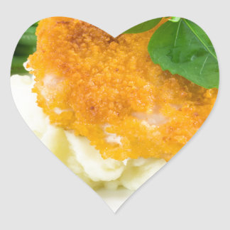 Nuggets of chicken, mashed potatoes and green bean heart sticker