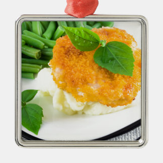 Nuggets of chicken, mashed potatoes and green bean metal ornament