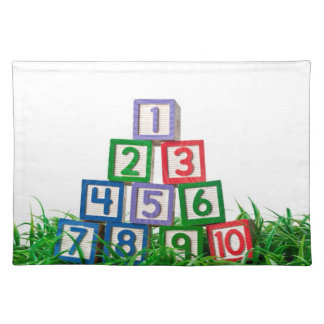 Number blocks stacked on grass cloth placemat
