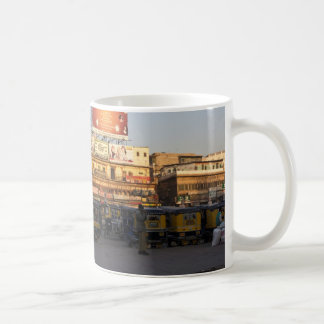 Number of parked auto rickshaws, shops and people classic white coffee mug
