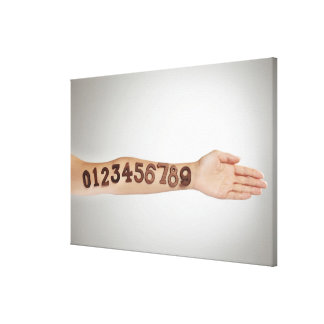 numbers affixed to the arm,ands close-up canvas print