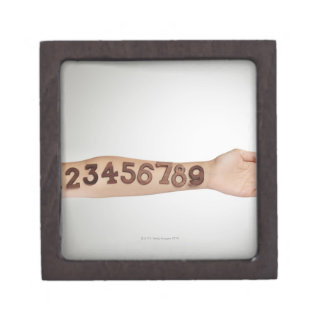 numbers affixed to the arm,ands close-up jewelry box