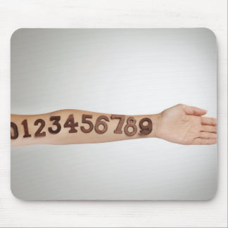 numbers affixed to the arm,ands close-up mouse pad