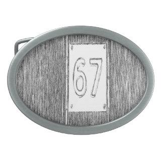número 67 hebilla cinturon oval