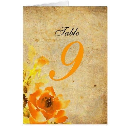 Número de asiento floral anaranjado de la tabla tarjeta de felicitación