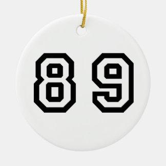 Número ochenta y nueve adorno navideño redondo de cerámica