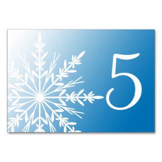Números azules de la tabla de los copos de nieve