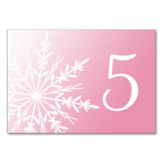 Números rosados de la tabla de los copos de nieve