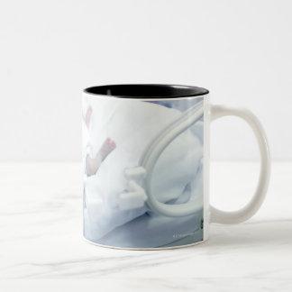 Nurse and premature baby Two-Tone coffee mug