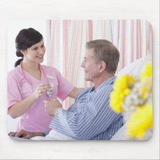 Nurse giving patient medication in hospital mouse pad