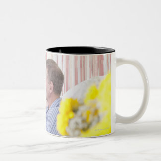 Nurse giving patient medication in hospital Two-Tone coffee mug