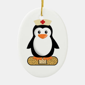 Nurse Penguin (w/bandaid) Double-Sided Oval Ceramic Christmas Ornament
