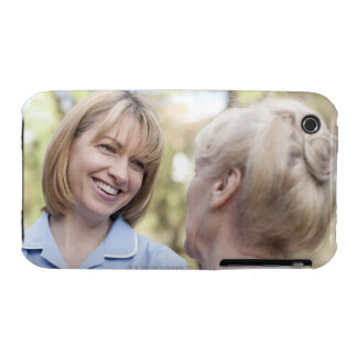 Nurse smiling and talking to a senior woman iPhone 3 case