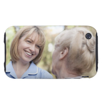 Nurse smiling and talking to a senior woman tough iPhone 3 case