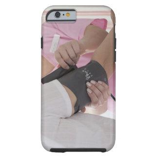 Nurse taking patient's blood pressure tough iPhone 6 case