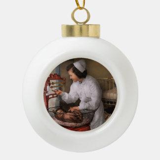 Nurse - The pediatrics ward 1943 Ceramic Ball Christmas Ornament