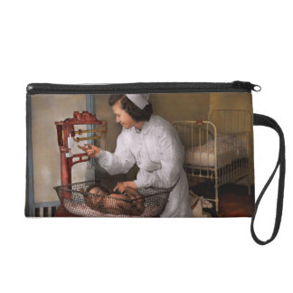 Nurse - The pediatrics ward 1943 Wristlet Purse