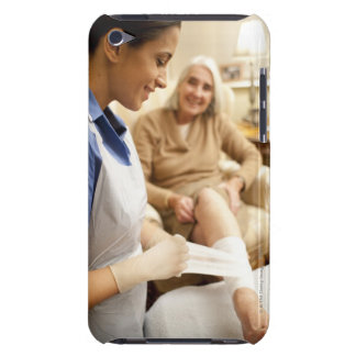 Nurse wrapping bandage on senior woman's leg to barely there iPod covers